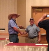 Tim Kenyon receives 2014 Career Achievement Award from SDSWMA Secr/Treas Mike Erickson